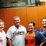Dentist, Stuart Rimes posing in Astros SWAG with staff
